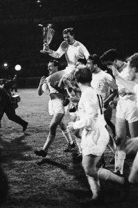 Danny Blanchflower lifting the UEFA Cup Winners' Cup trophy in 1963