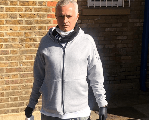 Spurs manager Jose Mourinho helps out the elderly